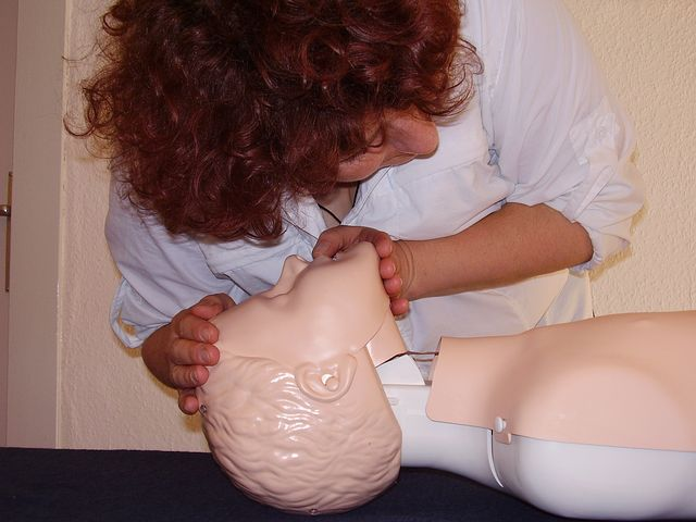 EMT Training CPR Student With Manikin