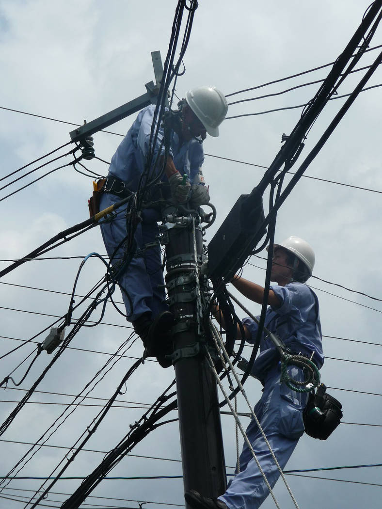 Electrician on Powerline at risk for electrocution