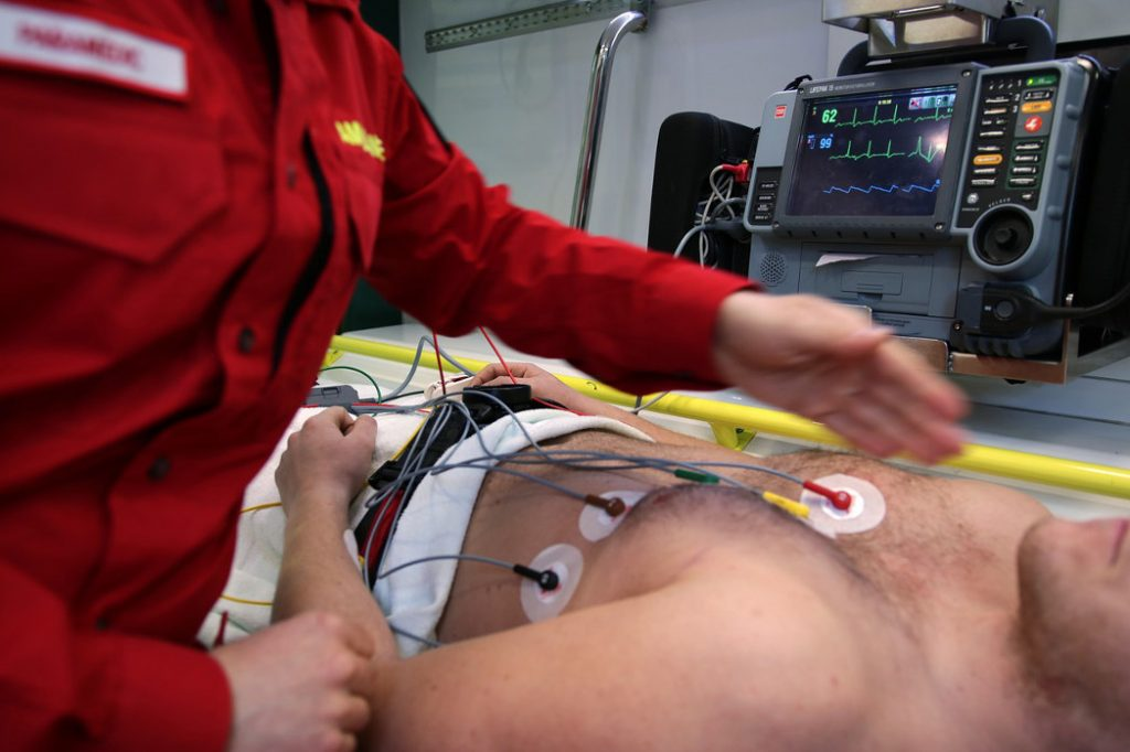 Paramedic with patient in ambulance ekg
